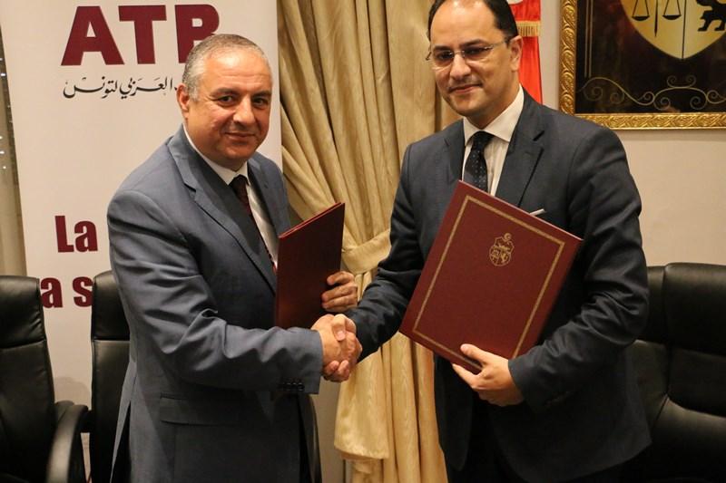 M. Mohamed Ferid Ben Tanfous, Directeur Général de l'Arab Tunisian Bank et M. Slim Khalbous, ministre de l'enseignement supérieur et de l'éducation par intérim