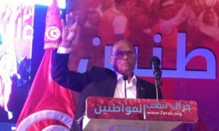 Marzouki fait signe de
